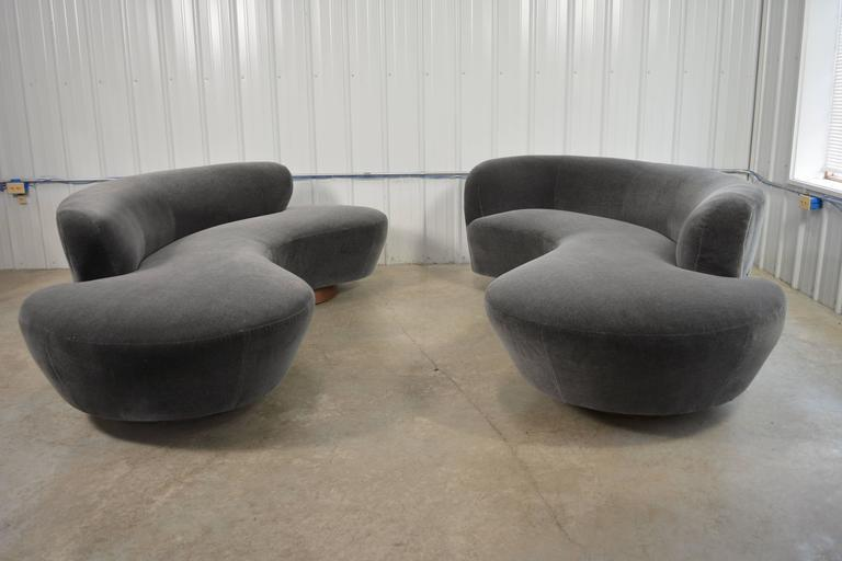 Sofa designed by Vladimir Kagan for Directional. Circular walnut plinth bases. Newly recovered in mohair. Lucite support plate. Directional label. Fabric samples available. A second sofa is available.