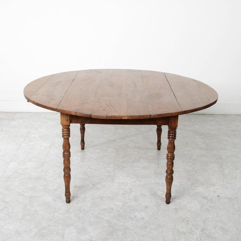 19th Century French Solid Elm Round Dining Table With Drop Leaves At 1stdibs