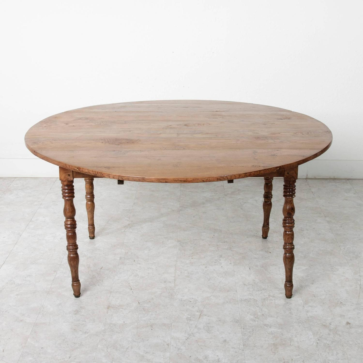 19th century french solid elm round dining table with drop leaves for