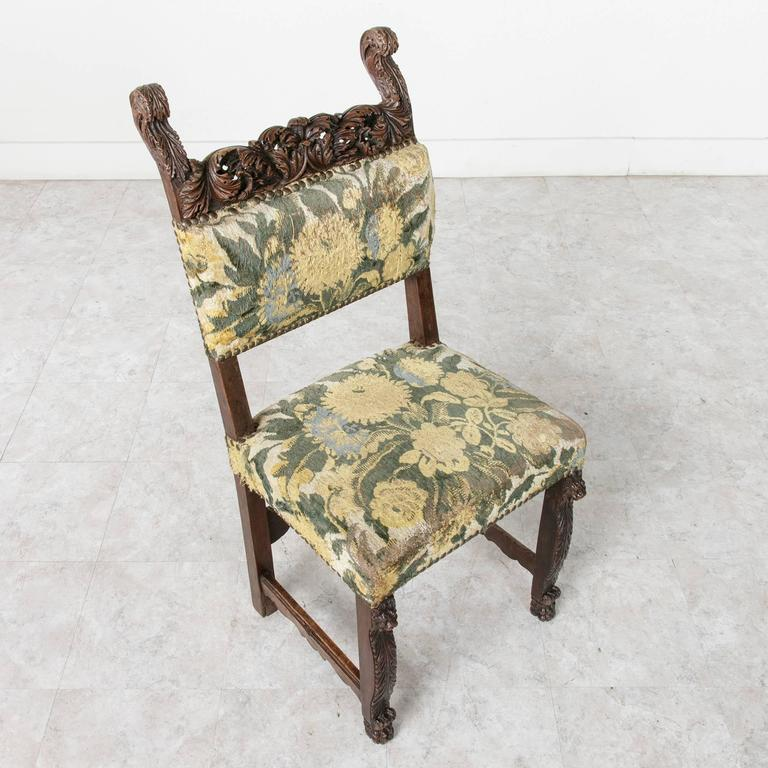 This sumptuously hand-carved walnut Louis XIII style side chair is a truly a rare find. The top rail of the chair features exceptionally deep relief carvings of acanthus leaves. The artistry of the wood carver defies understanding since the three