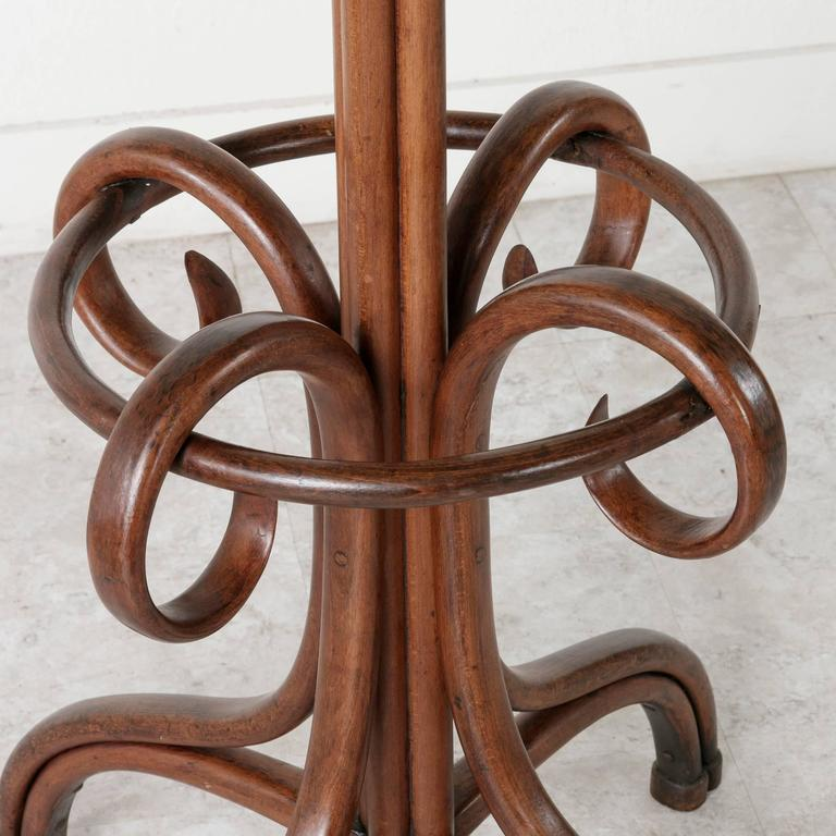 This Classic Thonet style hat and coat rack is made of richly finished bent beechwood. A familiar fixture in the early 20th century French bistro, this piece will bring a handsome touch to any entry or dressing space or to your own French café,