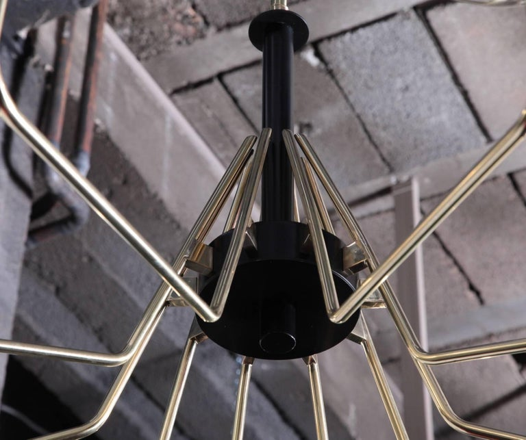 Monumental brass and black metal Sputnik chandelier with stained glass globes. The chandelier has a very impressing size and is a real eye-catcher in every room. The chandelier is in excellent condition. Measures: 10 x E27 model a bulb.  *This piece