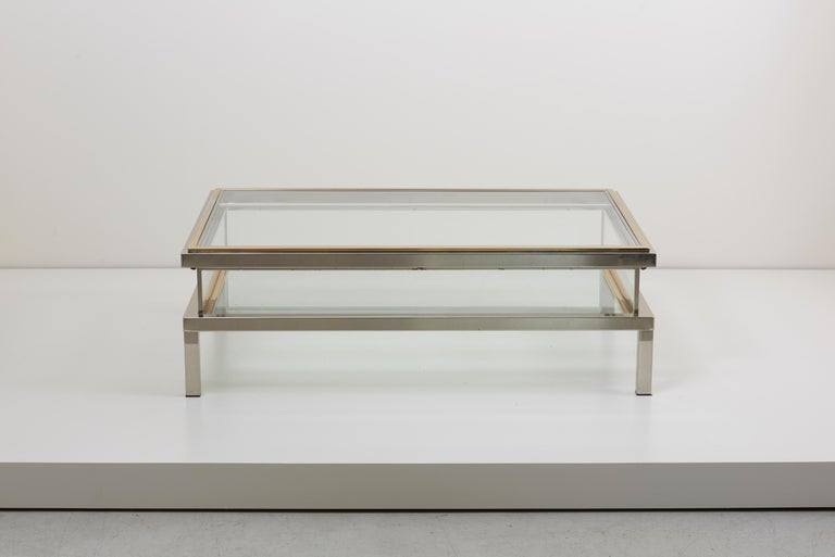 Elongated glass table with sliding top by Maison Jansen. Frame has an total original gold-plated and chrome metal finish.