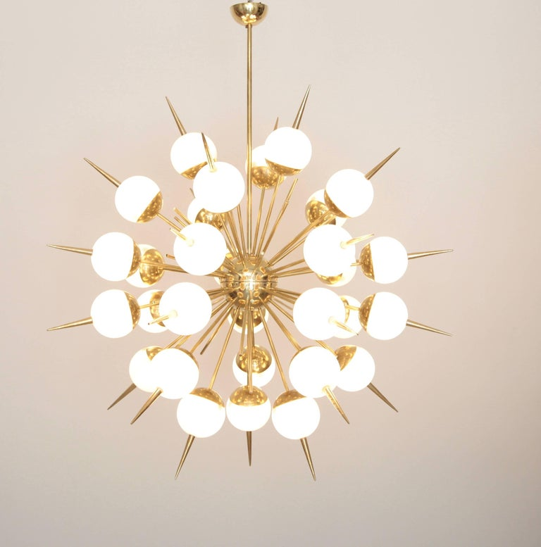 Exceptional huge mother of pearl colored Murano glass and brass Sputnik chandeliers. The chandeliers have a very impressing size and there are real eyecatchers in every room. The chandeliers are in excellent condition. Measures: 30 x E14. To be on