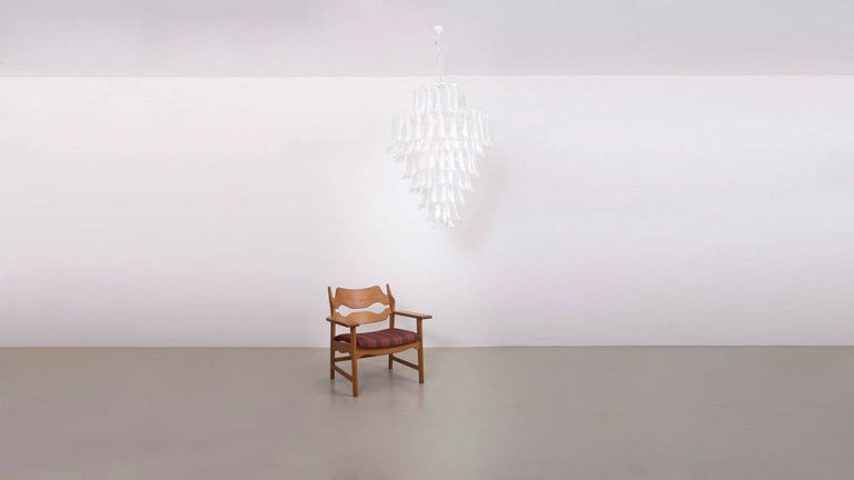 Very elegant and huge white Murano glass chandelier attributed to Mazzega. In this size and excellent condition such a chandelier is hardly to find. The chandelier is a eyecatcher for every room.  To be on the safe side, the lamp should be