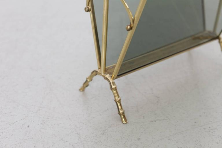 Very elegant faux bamboo magazine rack by Maison Bagues. The rack is made of brass and with smoked glass in an excellent quality. Very condition.