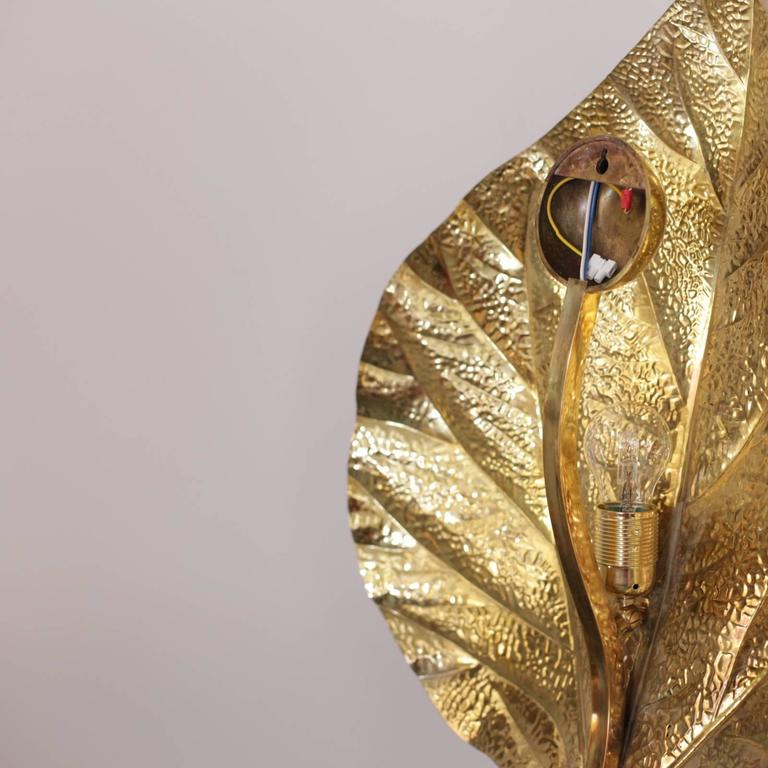 Set of two wonderful huge rhaburb leaf wall lamps by the Italian designer Tommaso Barbi. The lamps are made of brass and the reflexion of the light on the brass brings a cozy atmosphere in every room. The lamps are icons of the 1970s design and they