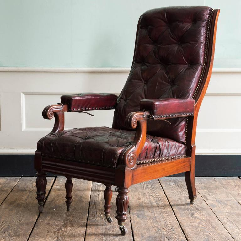 William IV mahogany reclining reading chair, upholstered in maroon leather, lacking articulated reading stand.