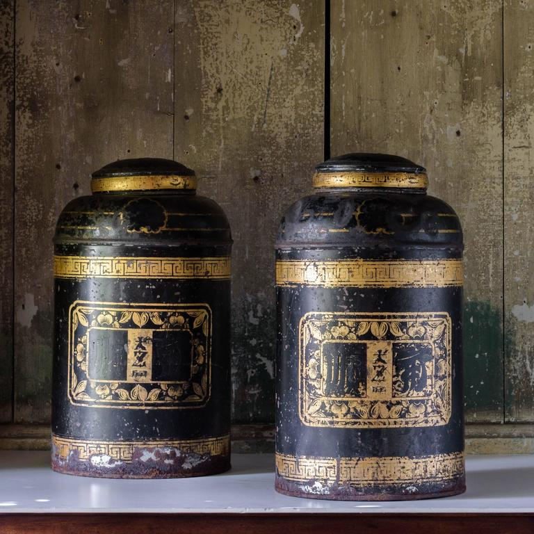 Late 19th century toleware tea canisters in the chinoiserie taste, with all-over gilt decoration.