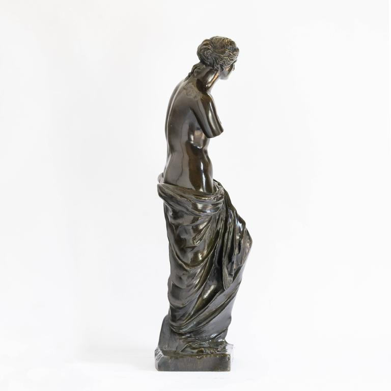 A bronze statue of Venus de Milo the Roman goddess of love, beauty, prosperity and fertility, after the antique, early 20th century.  Venus was of such high importance that the Romans claimed her as an ancestress and according to mythology, her son