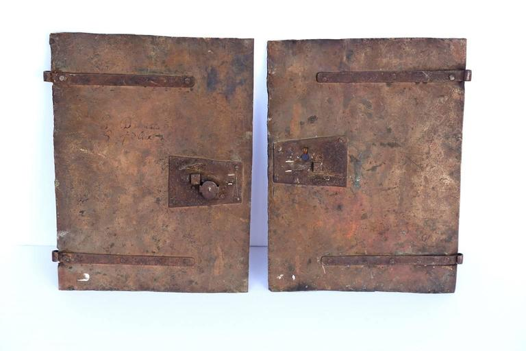 Pair of early oil on copper paintings (circa 1680-1700). Copper tabernacle doors, painted with scenes displaying saints. Continental European in origin, probably Italian, with writing on reverse. Priced for the pair.