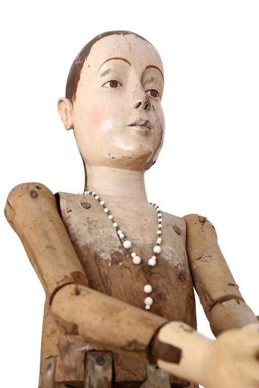 Large scale wooden French statue of saint, dated to the early 19th century. Hand carved polychome head, torso and hands raised upon a cage-style lower body. Articulated arms can be adjusted for various poses. Mortise and tenon construction. Solid