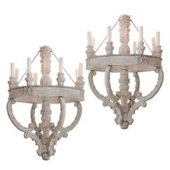 Pair of Large Round Carved and Painted Wooden Chandeliers