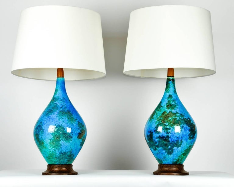 Vintage glazed ceramic table or task lamps, pair. Each lamp is in excellent working condition . Each one measure 32 inches high x 12 inches diameter. Each lamp come with a round drum silk interior shade . Each shade measure 12