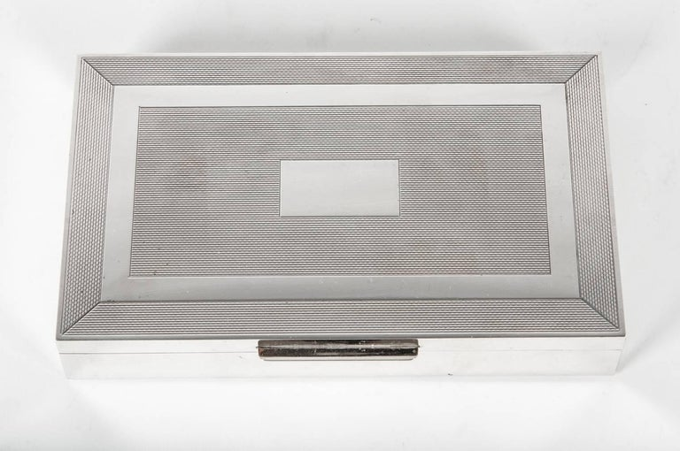 Midcentury Art Deco sterling silver box with wood interior. The sterling box  is in excellent vintage condition , maker's mark undersigned . The box measure 7 inches long x 4.5 inches width x 1.5 inches deep.