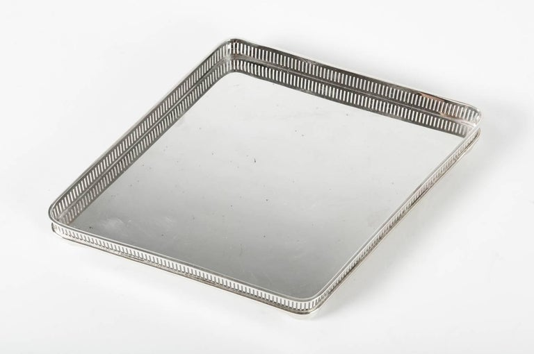 Vintage English geometric shape silver plate footed  barware / serving tray.  The tray is in excellent vintage condition. Maker's mark undersigned .  The tray measure 13 inches long x 9 inches width.