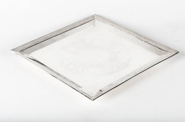 Vintage English Sheffield footed square shape silver plate barware  / serving tray. The barware /serving tray is in excellent vintage condition , maker's mark undersigned . The tray measure 12inches X 12 inches .