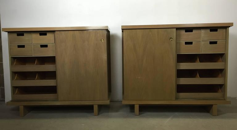 A pair of large matching chests with sliding doors and ten drawers finished in bleached walnut. Built & sold in the 1950s by American of Martinsville.