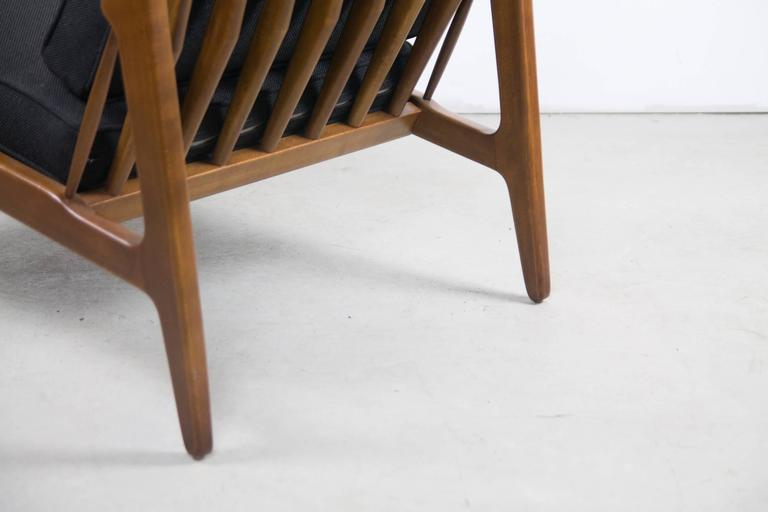 A lesser known slipper chair by Ib Kofod Larsen. The pitch and breadth of this chair allows for comfortable low slung lounging.