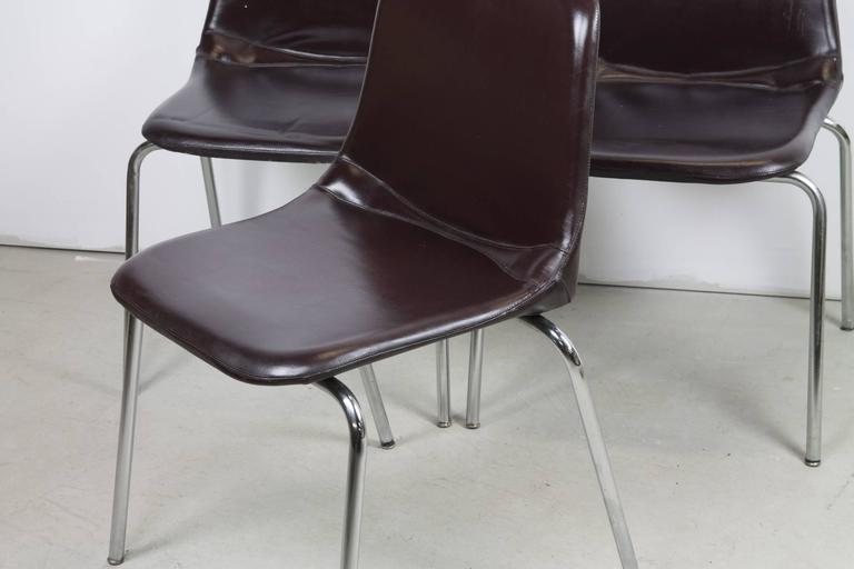Three simple side chairs by Ico Parisi forMIM Mobili with thin tubular steel legs and naugahyde upholstery.