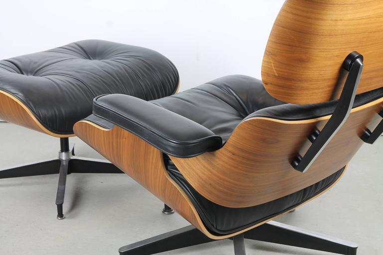 Mid-Century Modern Herman Miller 670 Walnut Lounge and Ottoman by Charles and Ray Eames