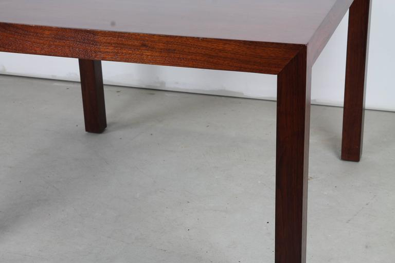 An elegant Parsons table in rich mahogany by Edward Wormley for Dunbar with original Dunbar metal tag affixed to underside.