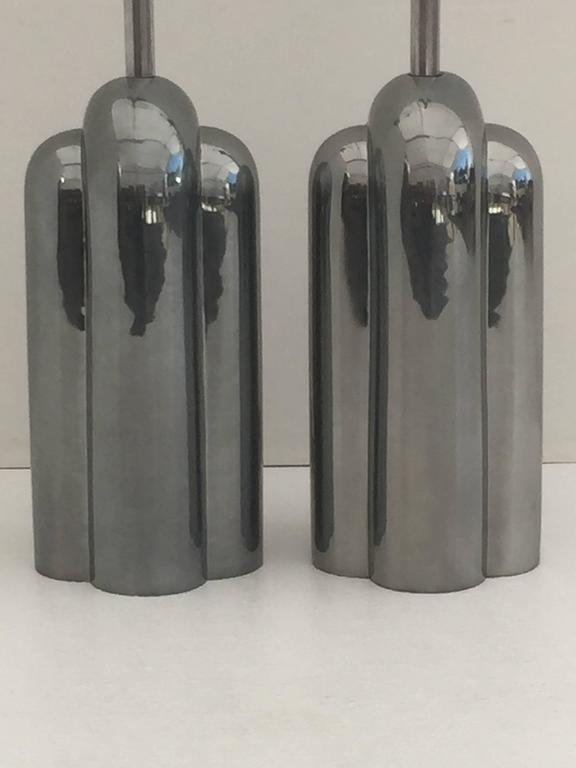 Pair of Art Deco streamline polished metal lamps by Westwood lighting.