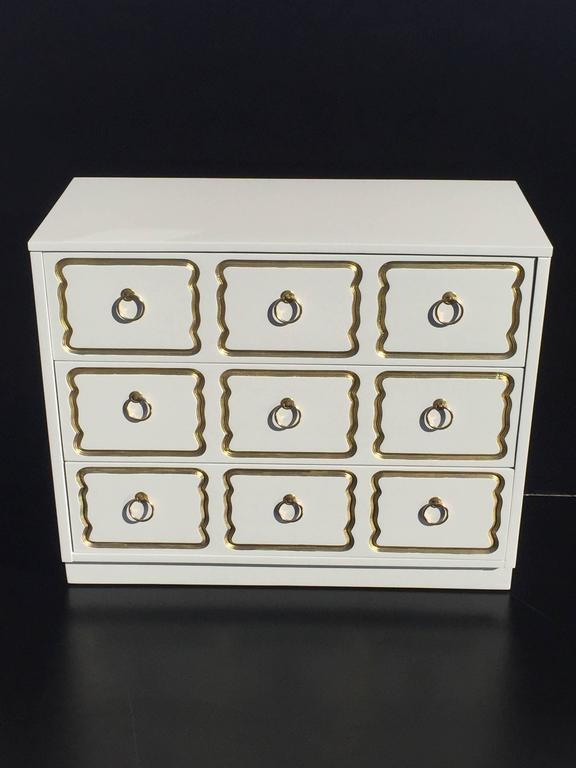 Espana chest of drawers in cream lacquer and gold by Dorothy Draper.