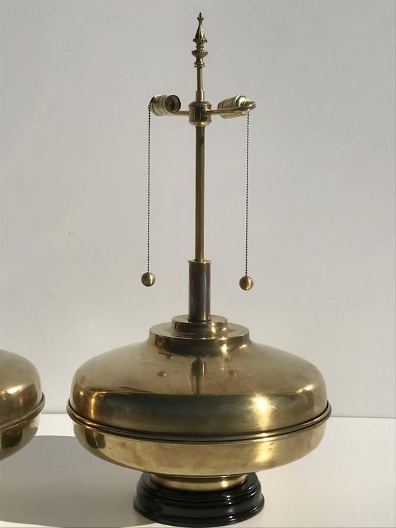 Pair of giant patinated brass lamps.