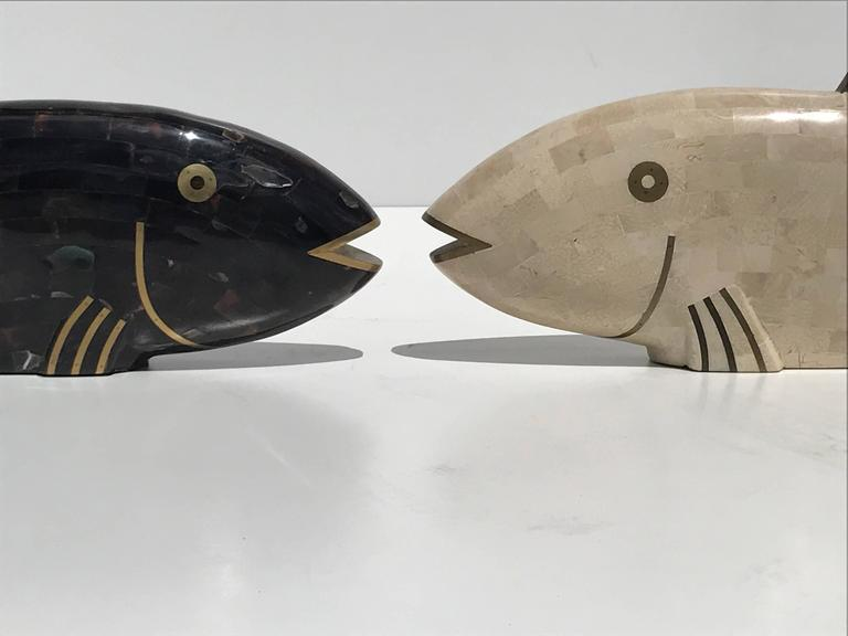 Pair of Maitland-Smith tessellated coral and horn fish sculptures.