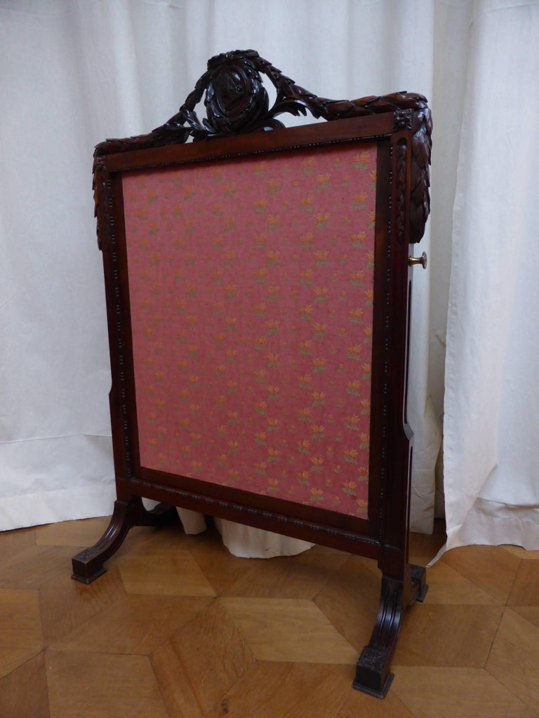 Rectangular, decorated with a central medallion flanked by two laurel swags, the feet decorated with rosettes.