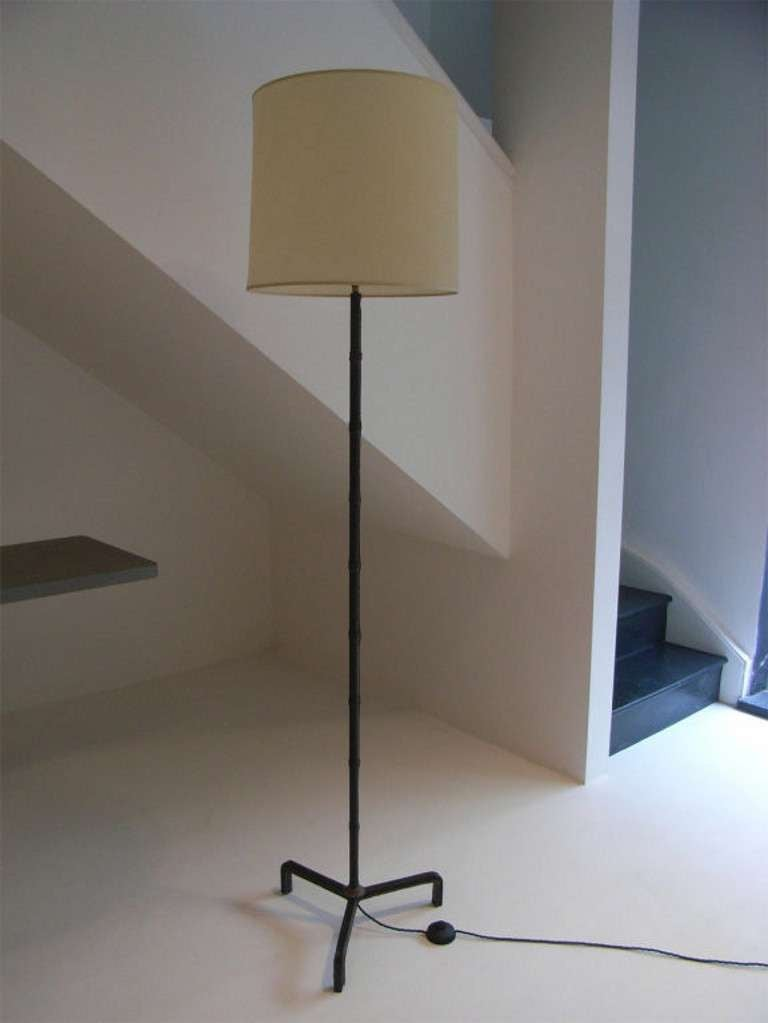 Stitched leather standard lamp in 'faux bamboo' style attributed to Jacques Adnet.