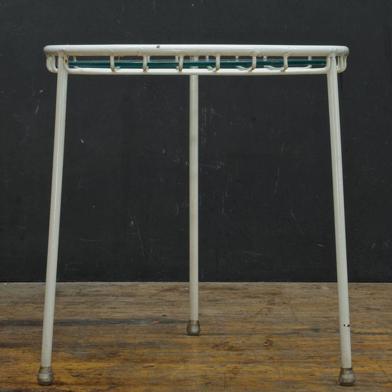 Extremely Rare Three Leg Round Design. Can be used with a glass top as show and included as a table, or with a cushion as a stool, however, there is no cushion included. It was only produced in 1951.