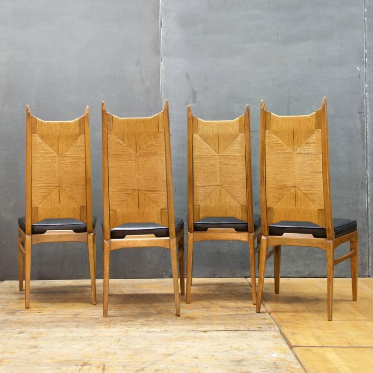 Midcentury Wooden And Black Vinyl Dining Chairs, Set Of Four.