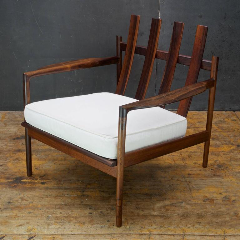 All original with original finish. The Frame is Excellent, Strong, Level and Sturdy. Original cushion a bit dingy. Imported from Denmark by Selig. Chair measures: W 29.75 x D 27.75 x seat H 16 x arm H 20 x back H 28.75 in.