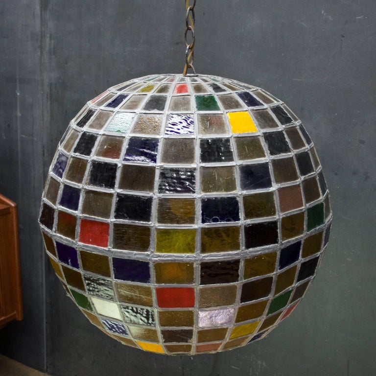 Very heavy, overbuilt lamp. super fun vintage multicolored globe chandelier. Round hatch on bottom on ball to change out a regular sized light bulb, 200 max watt.   Please note this item is showing a lots of wear, but we feel it is very worthy of