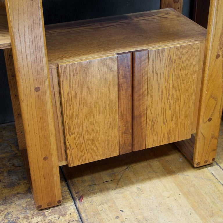 Rare low production California Craft Furniture. A self standing wall unit, shown here in a 3 Bay configuration. The seven shelves can be moved around, or removed and the drop-leaf desk bay and low cabinet bay columns can be used separately.  Hand