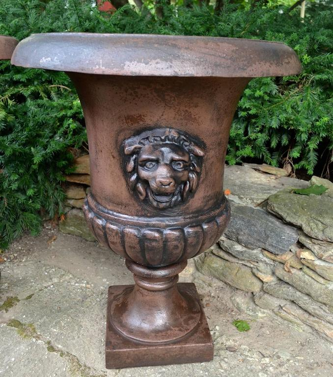 These Urns flanked a covered entry to a massive hedge maze, behind a Queen Annes County 1810s Mansard Mansion. Very Finely Casted, Rare Lions Head.  Mansion is Still Standing and Virtually unchanged by its many owners. Wonderful Condition, No