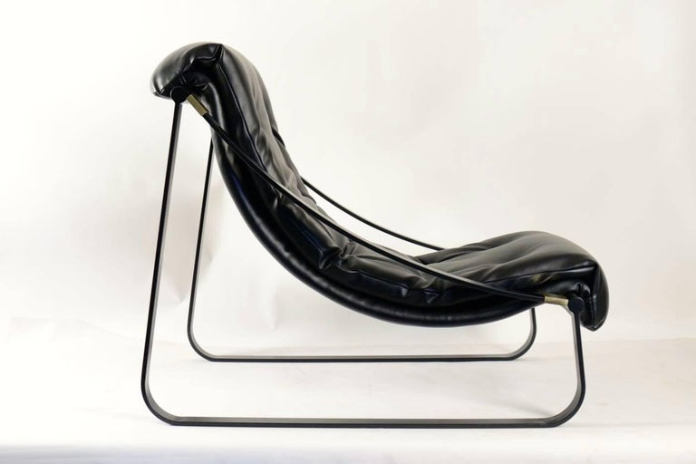1970s pair of black lounge chairs