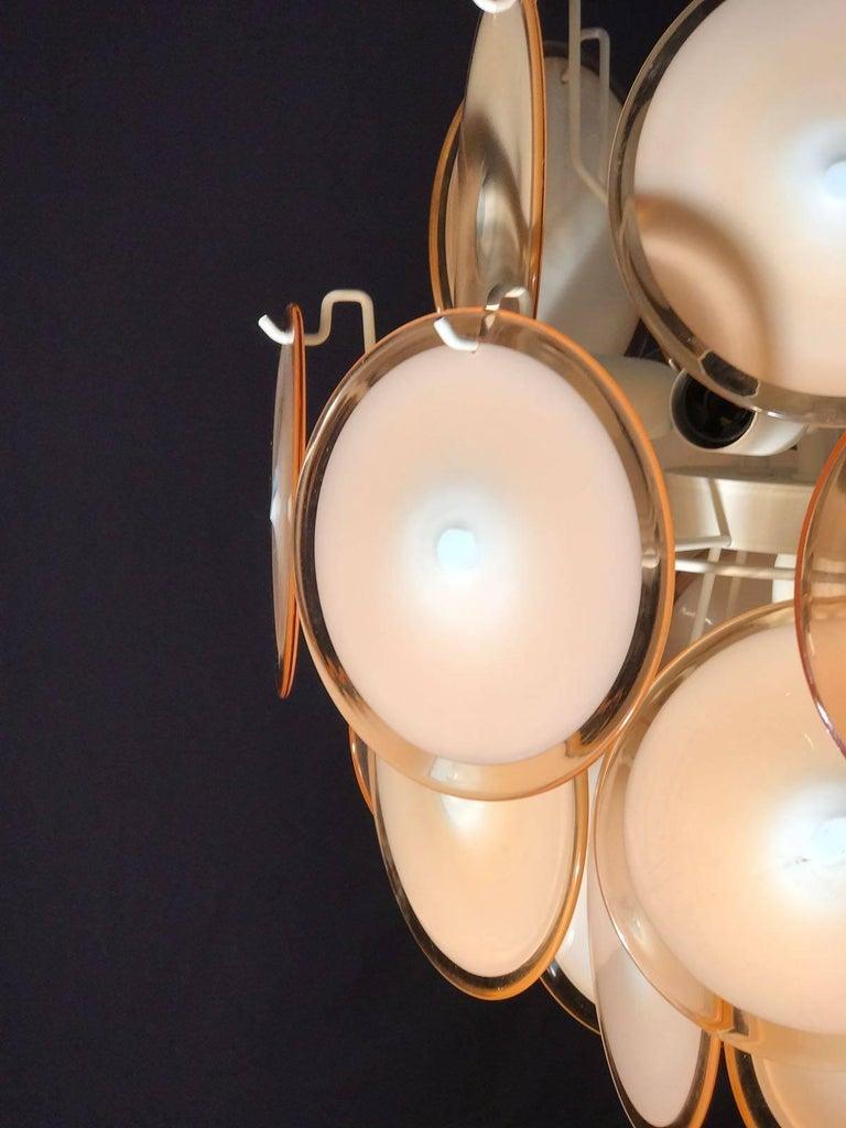 Mid-Century Modern Pair of Vistosi Midcentury Amber Murano Glass Discs Italian Chandeliers, 1970s For Sale