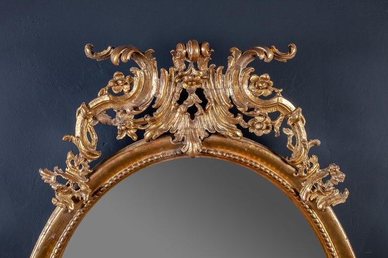 Finely carved elegant mirror with original gilding.