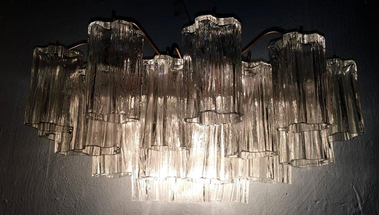 "21 handblown glass tubes on each sconce, each measuring 4.72"" long."