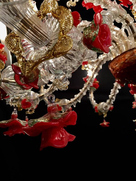 Beautiful Murano chandelier with 24-arms and a multitude of flowers in glass paste and gold inclusion.