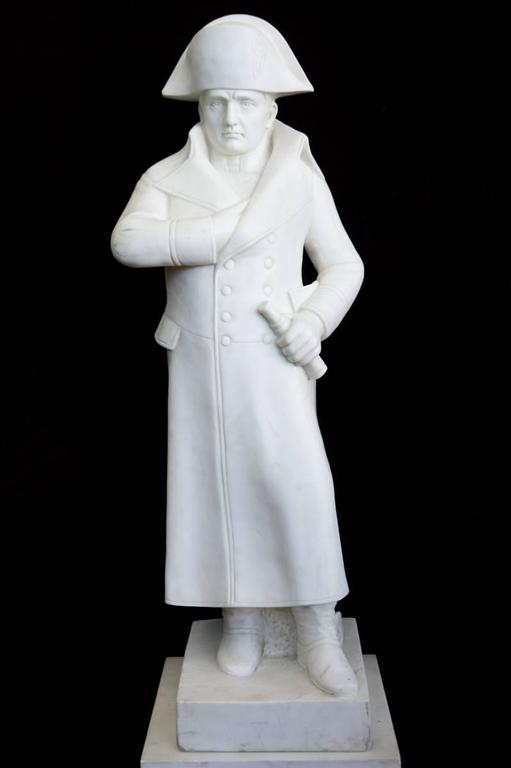 A white carved marble figure of the famous Napoleon with one hand in his jacket, on a gilt bronze mounted marble pedestal.  Height 74