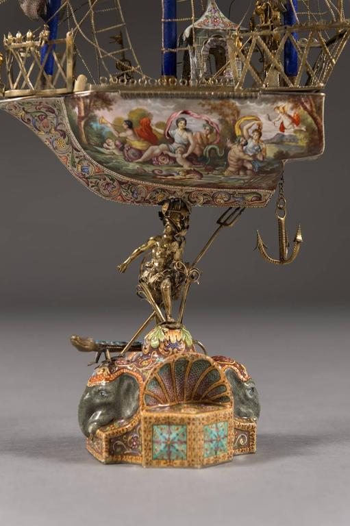A Very Fine Viennese parcel-gilt silver and enamel sailing ship by Rudolf Linke, Vienna, circa 1885-1903.  The silver enameled vessel supported on the back of the Greek mythological figure Poseidon. The base with two elephant heads and a