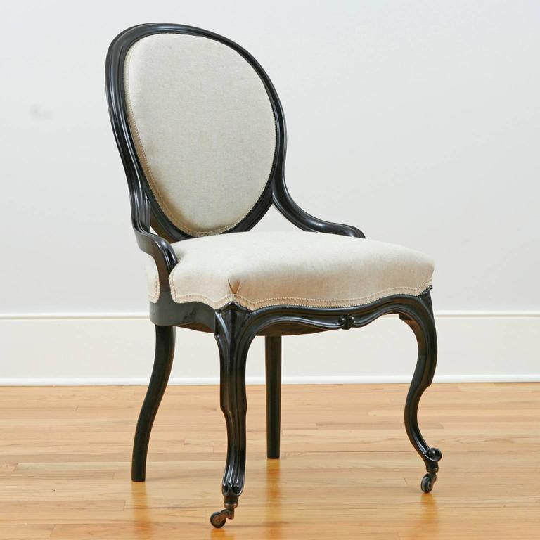Set of four Napoleon III ebonized salon chairs with balloon-back, cabriole legs, upholstered back and seat. France, circa 1870. Beautifully restored frames with original ebonized wood. Springs have been re-tied in the process of re-upholstery. Very