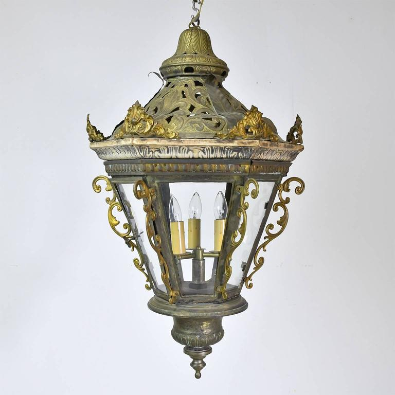 A very beautiful and highly decorative pair of Baroque style Belle Époque Gondola Lanterns from Venice in hand-cut and hand-hammered metal with some cast elements, gesso and brass decorative details. Converted to electric, Italy, circa late