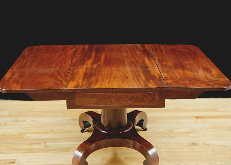 Polished American Empire Greek Revival Drop Leaf Dining Table In Mahogany Circa 1830 For