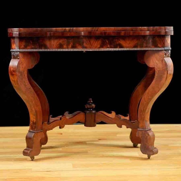 American Empire card table in mahogany with pivot, fold-over top opening to square Attributable to well-known cabinetmaker Meeks & Sons New York City, circa 1840 American Empire game table, works well as a side table, end table, lamp table, game