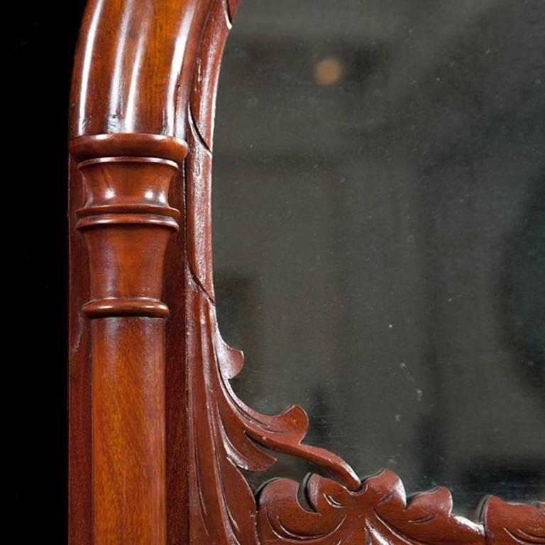 Polished Danish Antique Decorative Arched Mirror in Mahogany w/ a Carved Bonnet and Swag For Sale